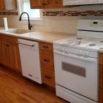 Custom kitchen with hardwood floors.