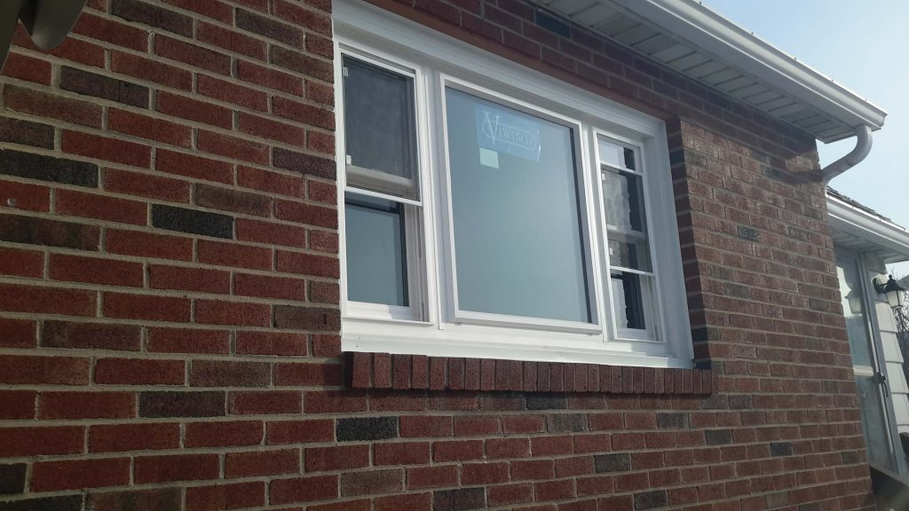 Newly-installed window in a brick home.