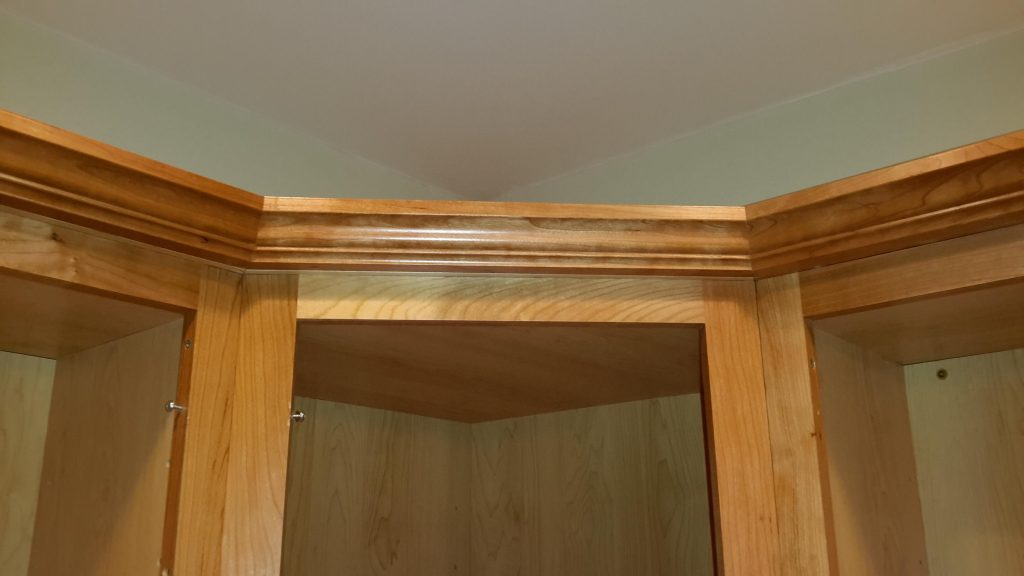 Detail and trimwork on a custom built-in shelf.